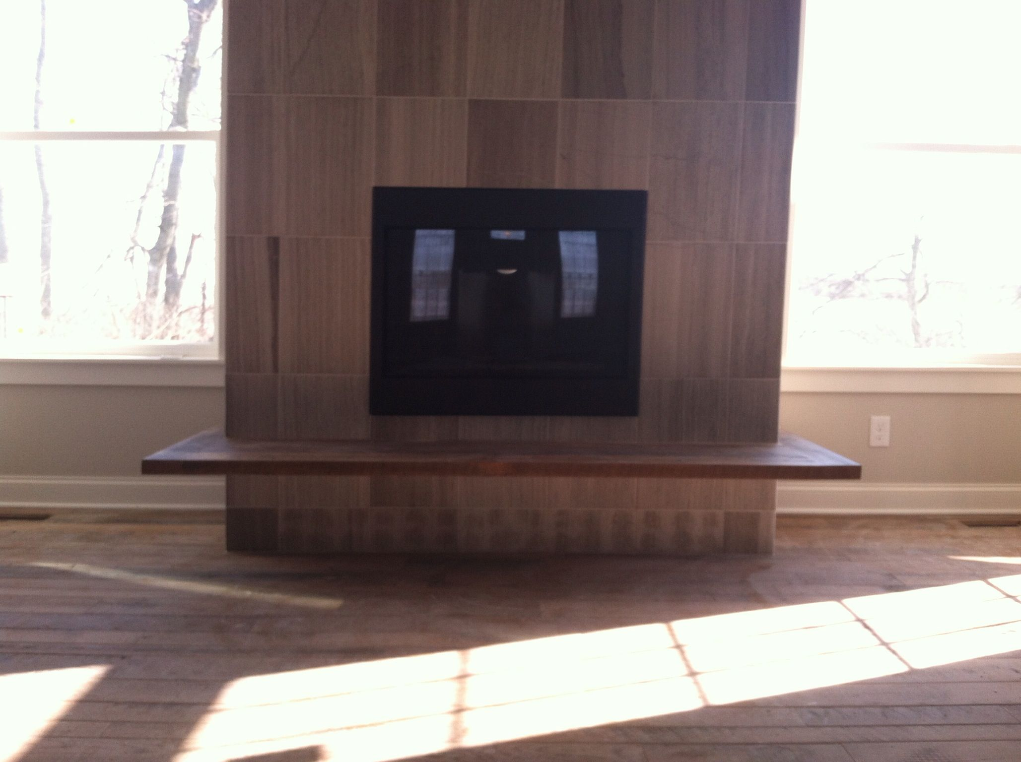Floating wood hearth on marble fireplace | Creative ...