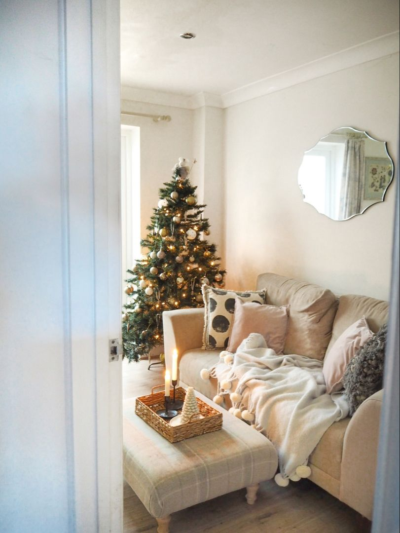 How to style your home for Christmas with this small house tour featuring budget white and gold themed Christmas decorations and festive accessories #christmasdecor #christmastree #christmashome