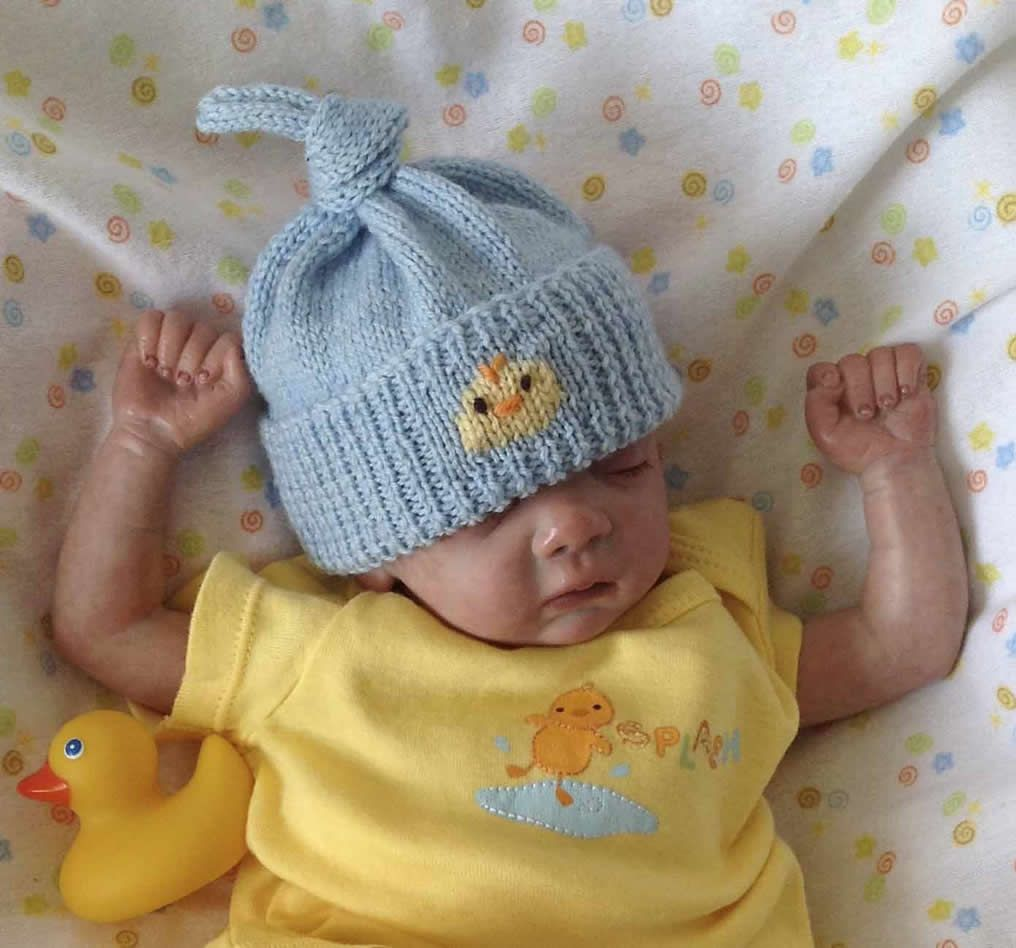 Knot Born Yesterday Hat This knitted top knot hat is suitable for a ...