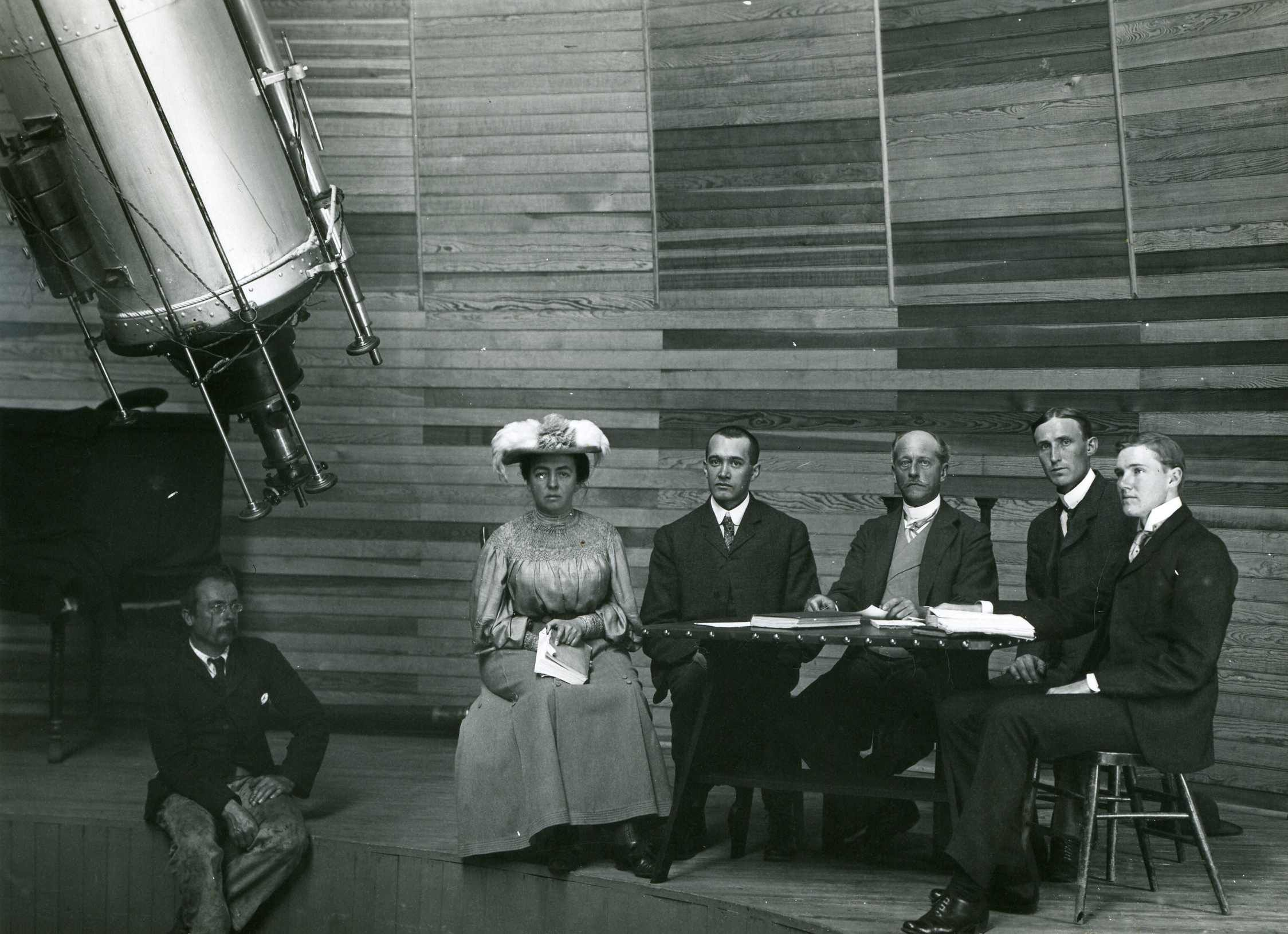 Lowell staff seated by the Clark Telescope in 1905. Left to right: Harry Hussey, Wrexie Leonard, V.M. Slipher, Percival Lowell, Carl Lampland, and John C. Duncan.