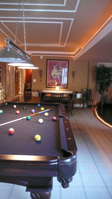 Big Game Room with pool table and all kinds of great games-foosball,pacman,pingpong,chess,board games, large flat screen for Wii, etc etc.