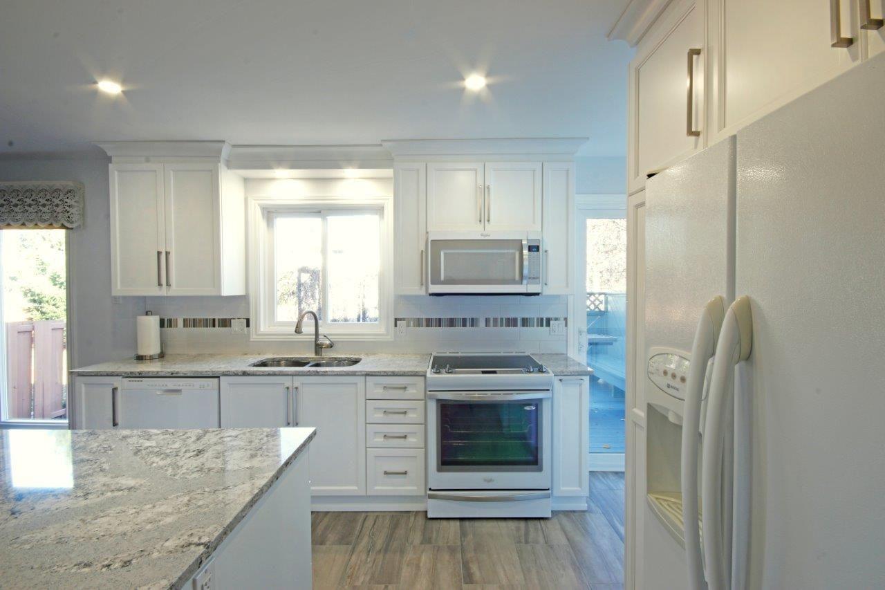 Crisp White Cabinetry Custom Kitchen Cabinets Best Kitchen Cabinets Kitchen Renovation