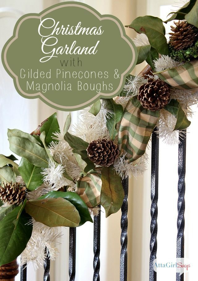 handmade christmas garland of magnolia boughs and gilded pinecones