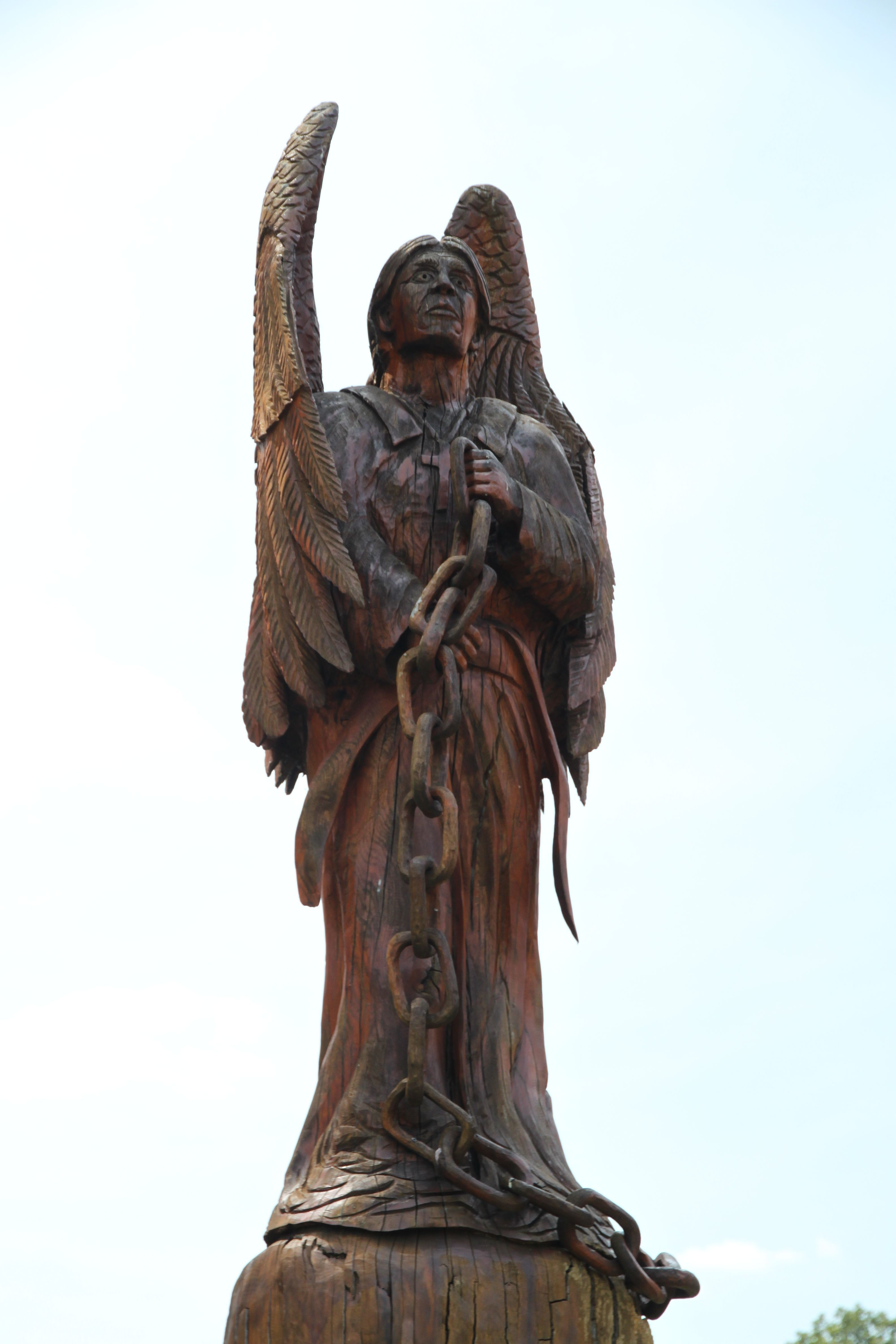 Indian angel chainsaw wood statue carved by dayton scoggins in