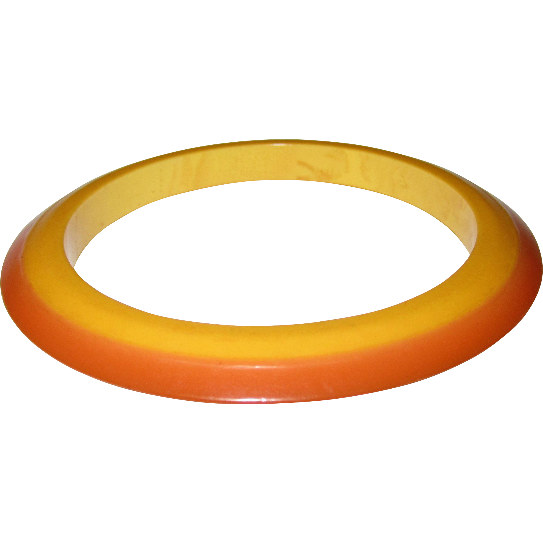 Vintage Fall Jewelry -- Laminated Two-Tone Bakelite Flying Saucer Bangle Bracelet -- found at www.rubylane.com #vintagebeginshere