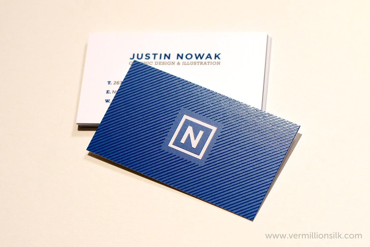 justin a graphic designer designed his silk business cards with spot uv gloss on