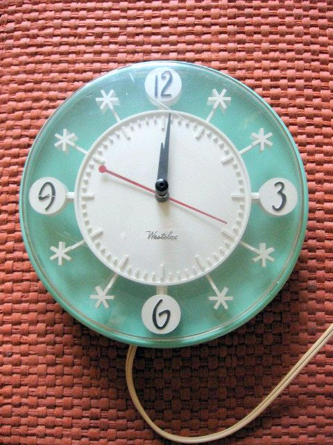 1950s Teal Plastic Snowflake Electric Kitchen Clock By