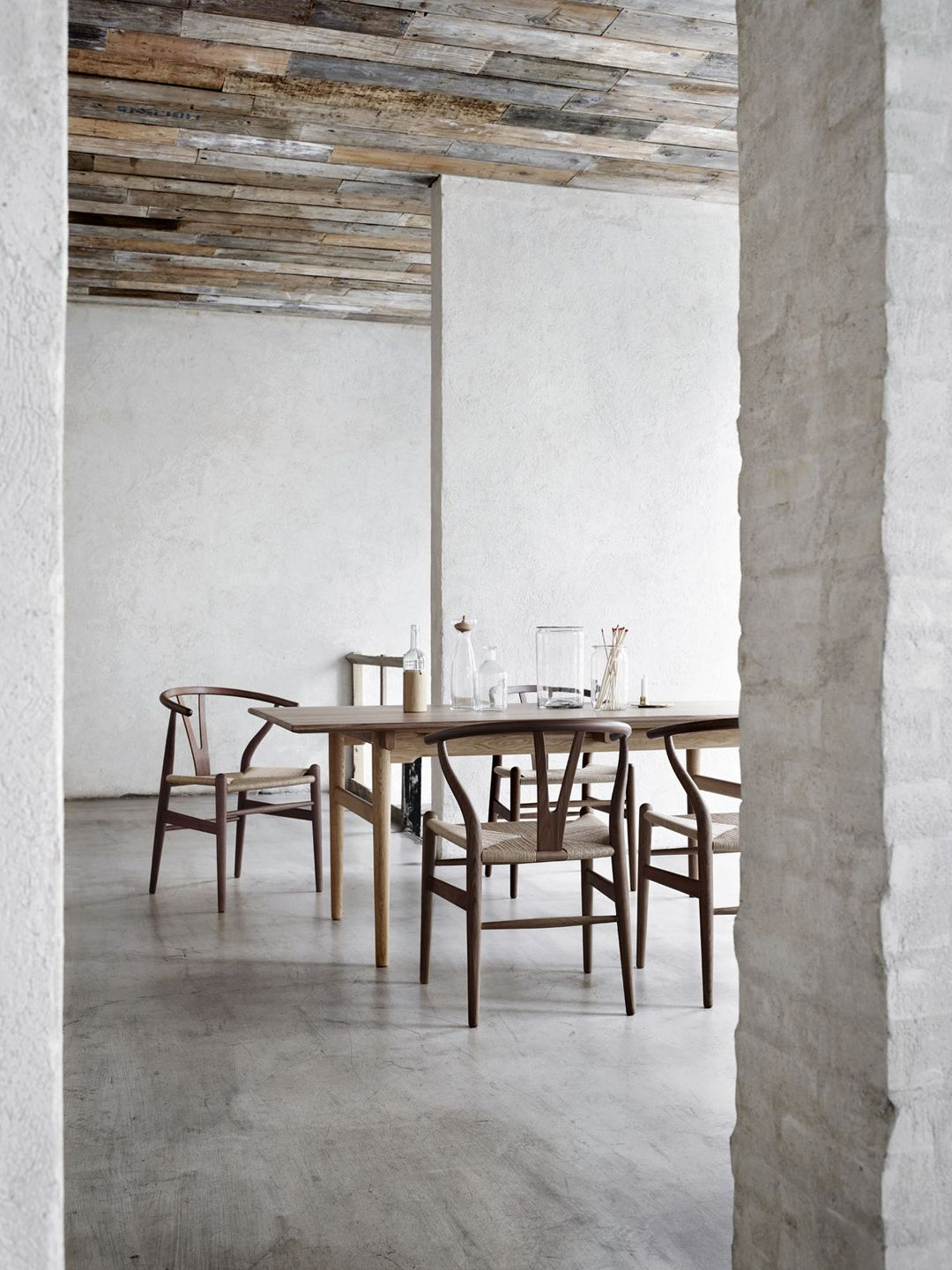 Suspended table by berstein architects - 9 Handsome Spaces That Will Make You Crave The Limited Elm Wood Wishbone Chair Bungalow5