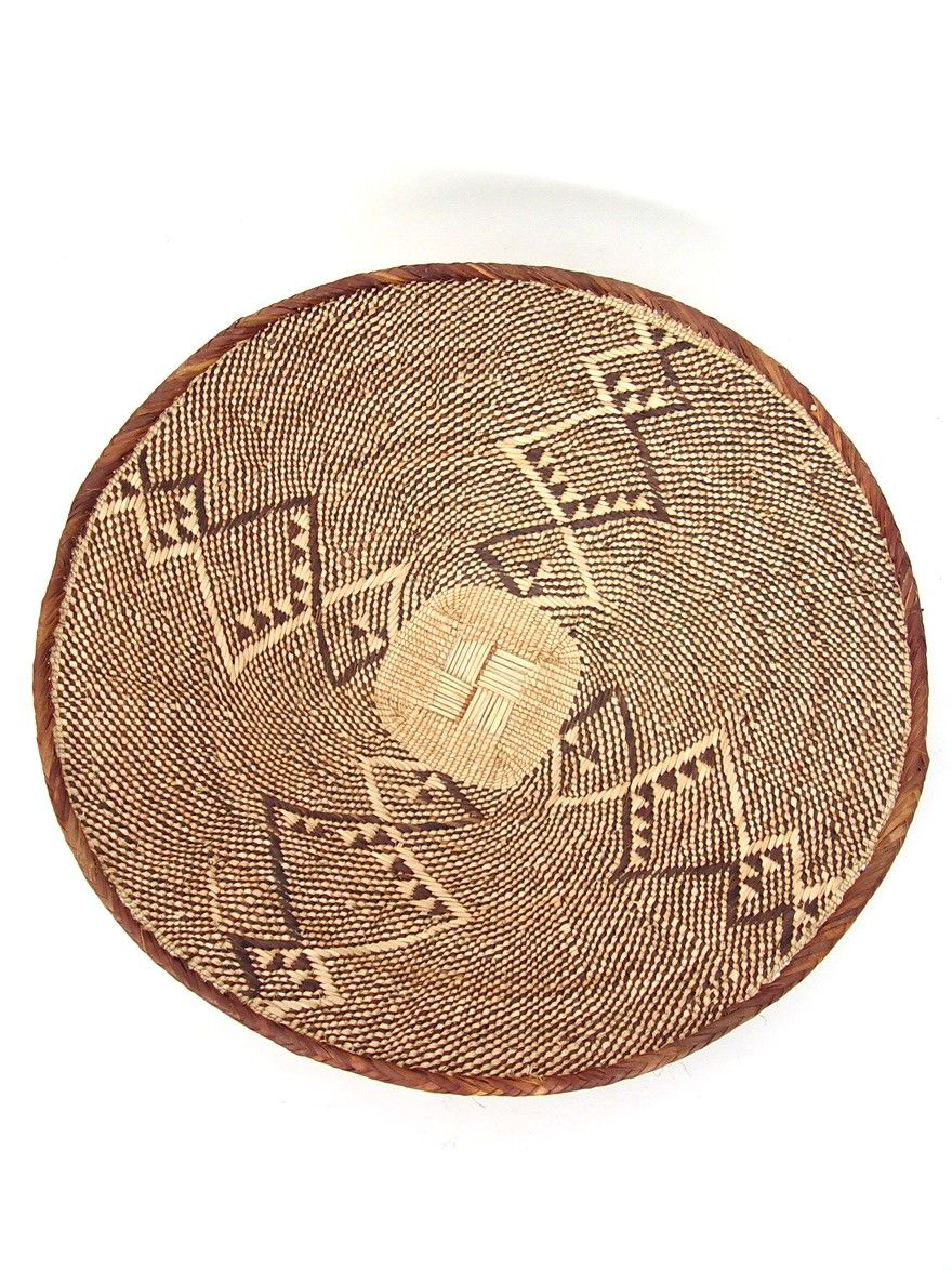 Binga Basket - Large    $48.00. These baskets are made from all natural and locally harvested materials such as wild grasses, small vines, and palm leaves dyed with tree bark. The largest sized bowls are still used by the Tonga people for their original purpose of winnowing grains.    When you purchase a fairly traded item like this African basket, you receive a beautiful artisan product while helping a family in a developing country raise their standard of living.
