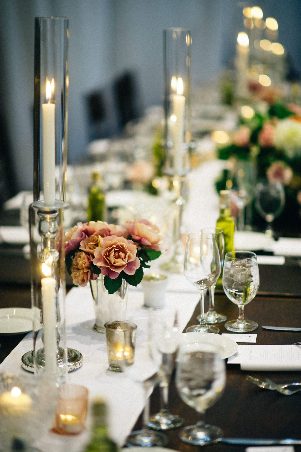 wedding tablescapes - photo by Shoda Love http://ruffledblog.com/this-elegant-wedding-has-an-amazing-escort-card-display