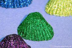 Ariell hätte ihre Freude an diesen schimmernden Muscheln! Viel Glitzer und Glamour für die Meerjungfrauen- oder Strand & Meer-Party.