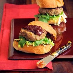 Duck sliders are both familiar and exotic. Crunchy Napa cabbage and sweet savory fig ketchup complete this burger.