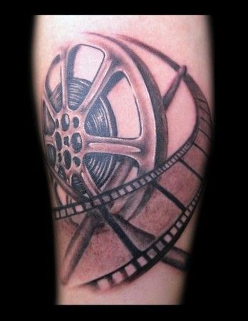 Where can I find the film reel tattoo done on miami ink
