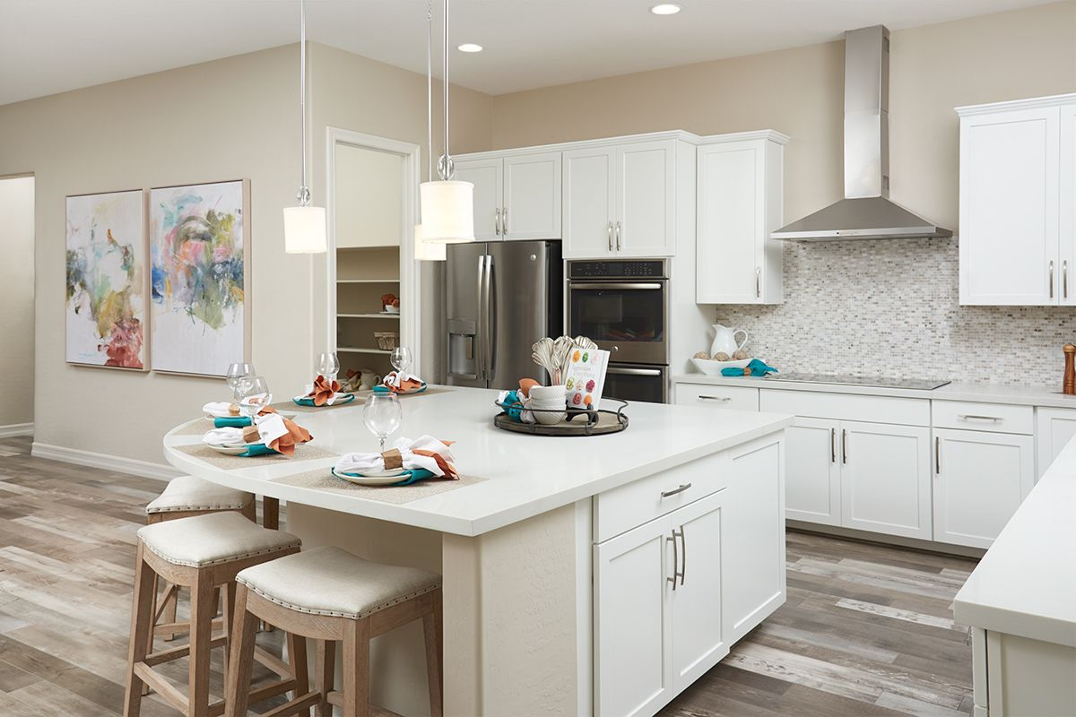 Pendant lighting at a curved kitchen island with seating | Stephen ...