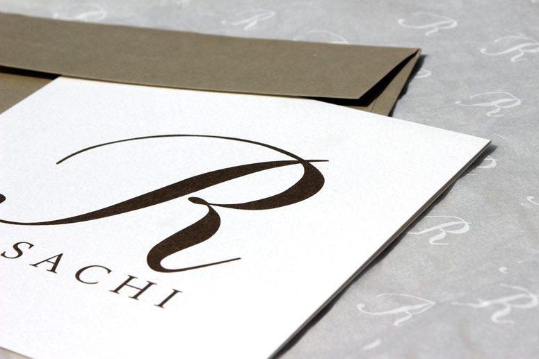 envelope and invitation card for Rosachi By CREA OFFICINA
