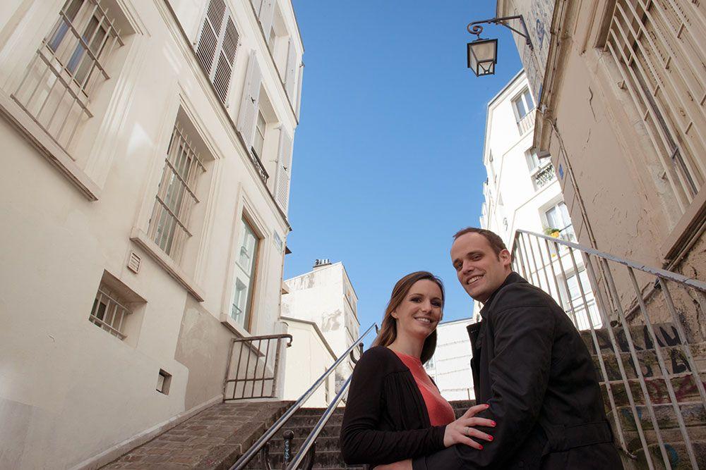 Happy couple on Montmartre steps by TripShooter Paris photographer Jade Maitre.