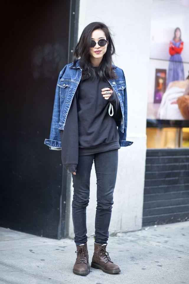 Qweary: Female Stud Skater Style - Denim jacket black sweatshirt black skinny jeans brown lace-up boots.