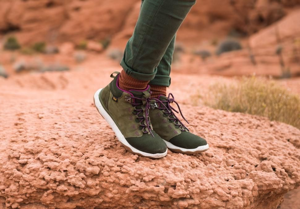4a4881e8d3b13 Woman standing on red rocks wearing Arrowood Mid boot in Olive.