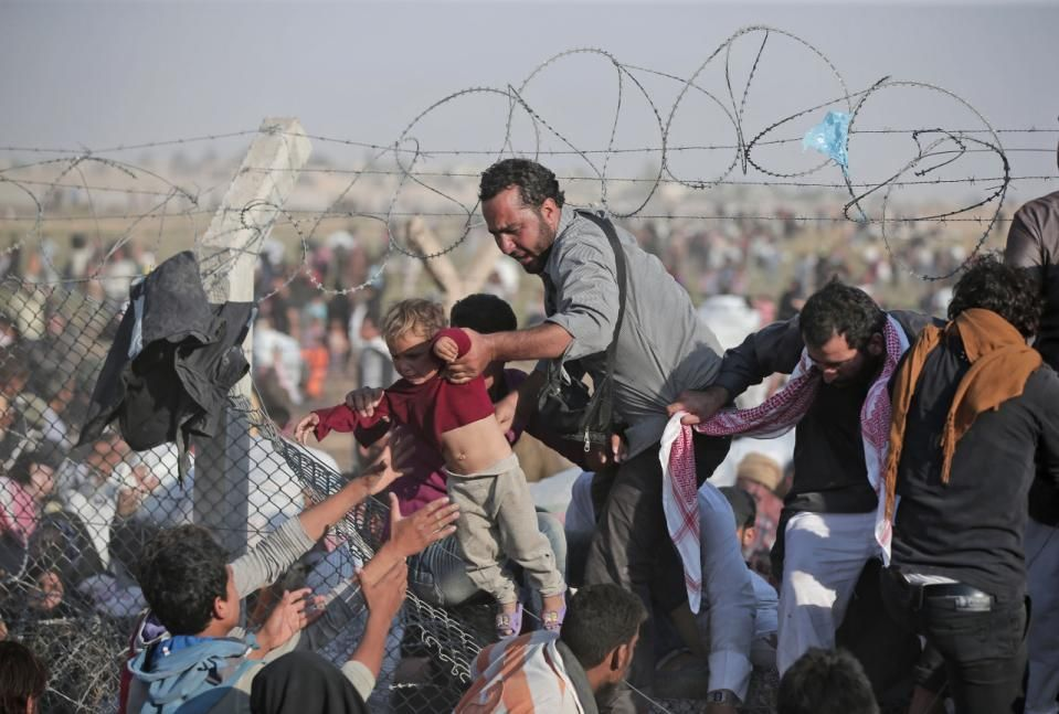 In This Sunday June 14 2015 File Photo A Syrian Refugee Carries