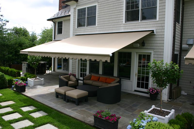 This Retractable Awning Provides Shade Over The Back Patio When