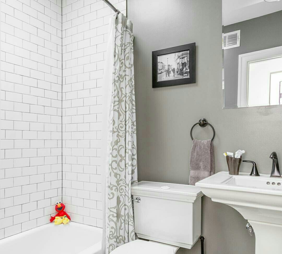 Elmo in the bathroom! Loving the pop of color in this monochrome bathroom! Just thought I'd share a photo that made me smile from a recent #realestatephotography shoot. I probably would not have hated baths as a kid if #elmo was waiting for me! #altdigitalphotography #bathtoom #monochrome #subwaytile #interiorphotography #interiordesign #homedesign #homedecor #bathroomdesign #bathroomdecor #NomadicRE #igdc #acreativedc