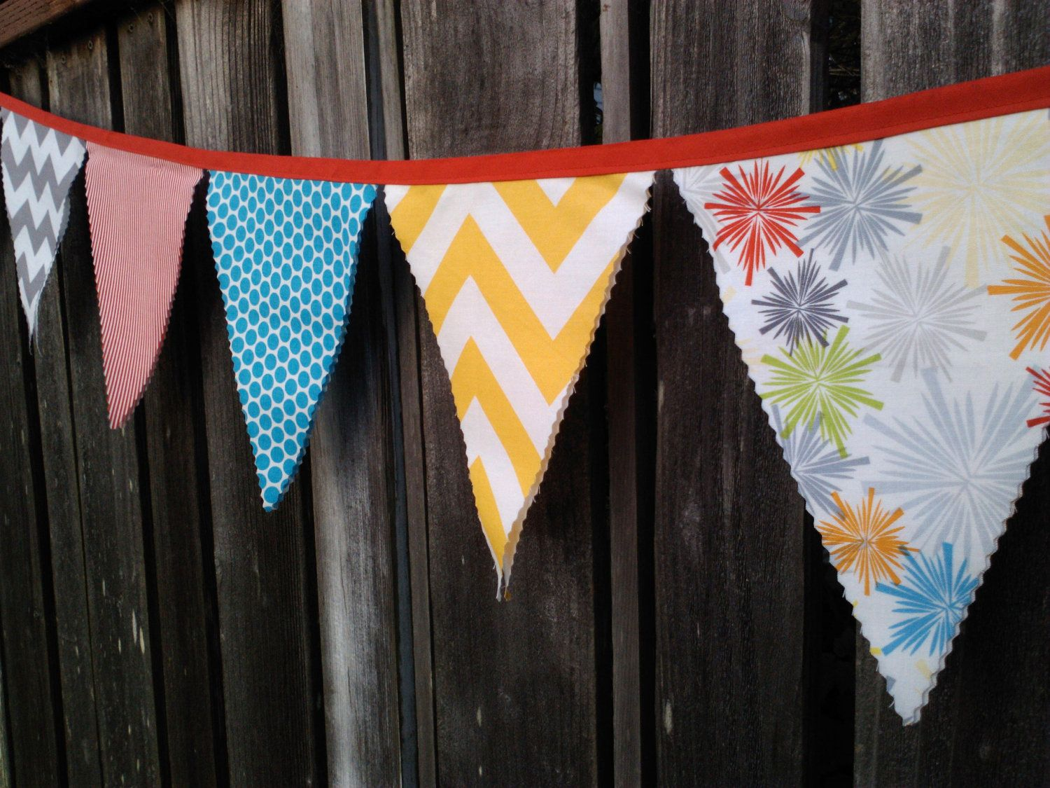 Fabric bunting flags yellow and grey chevron red stripes fireworks