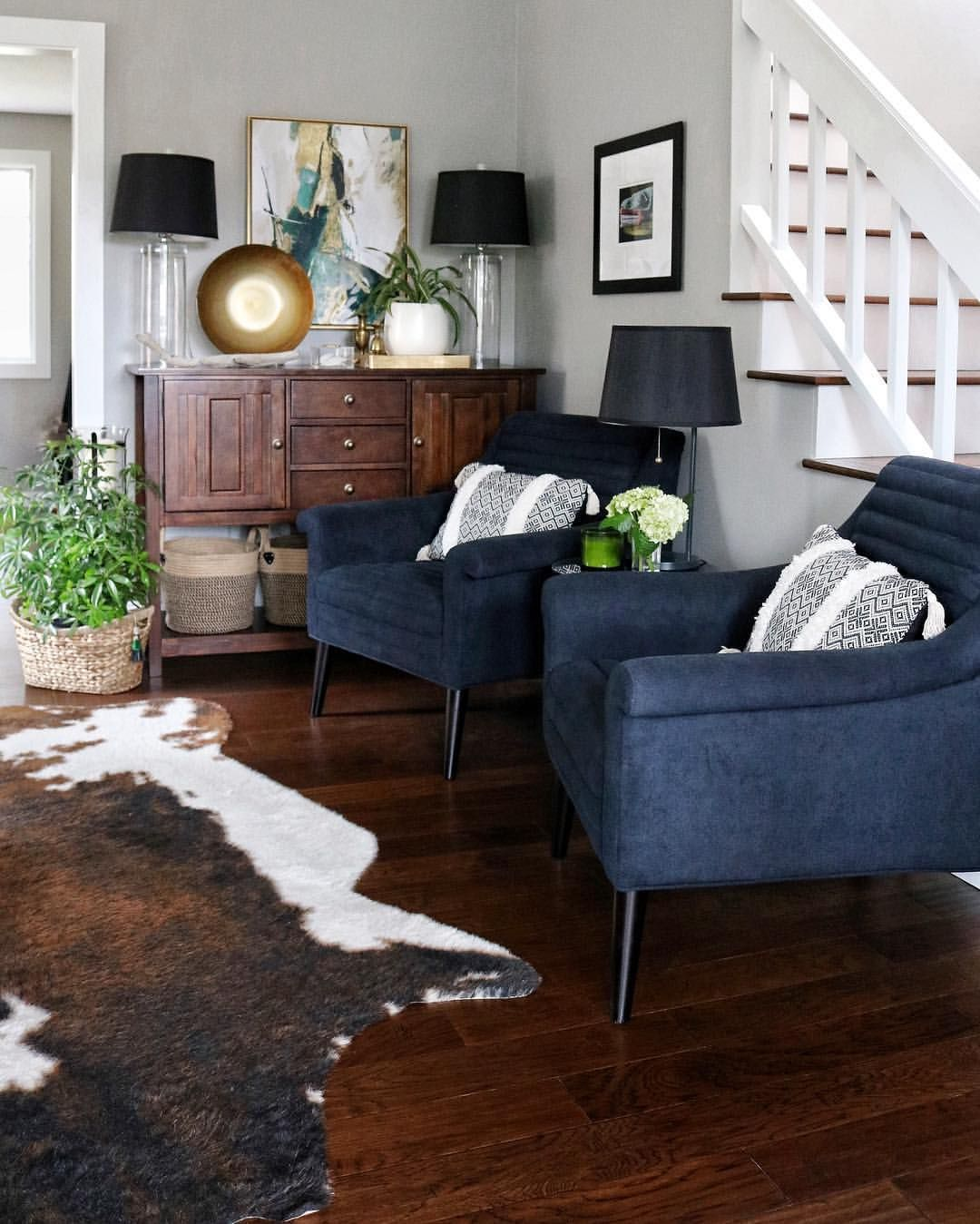 Living Room with Navy Chairs & Faux Cowhide Rug | Living ...
