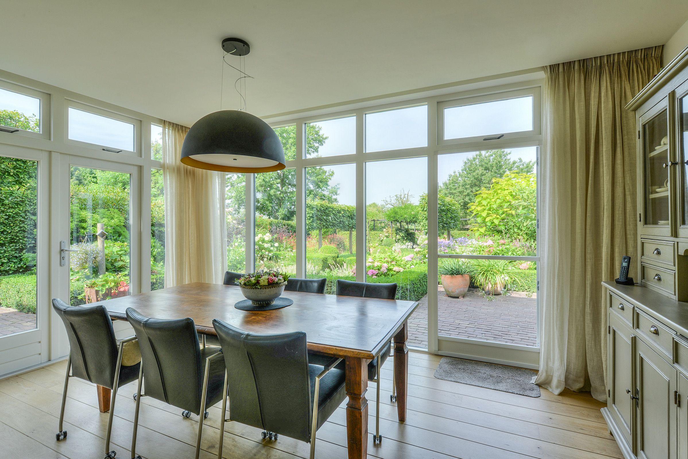 Eetkamer met glas tuinkamer verbouwing vrijstaande woning