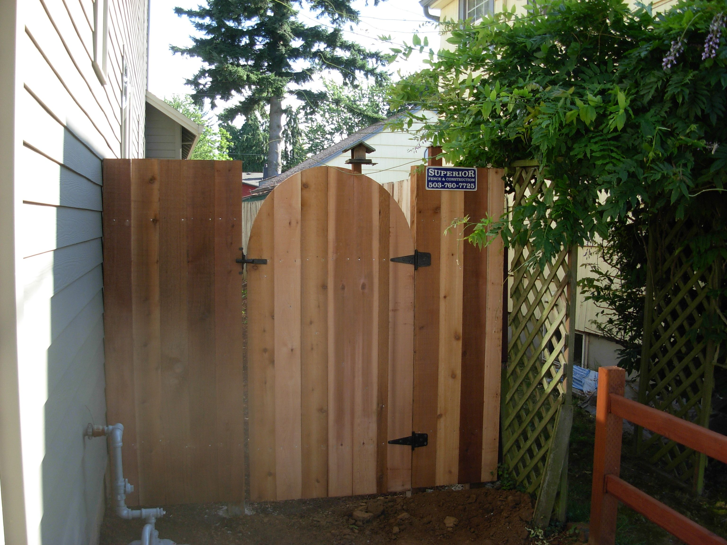Round Top On A Solid Board Gate Wood Fence Fence Construction