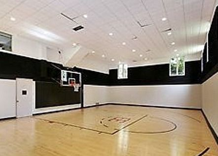 Pippen S Former Home Site Of Bizarre Garage Sale Home Basketball Court Indoor Basketball Court Basketball Court