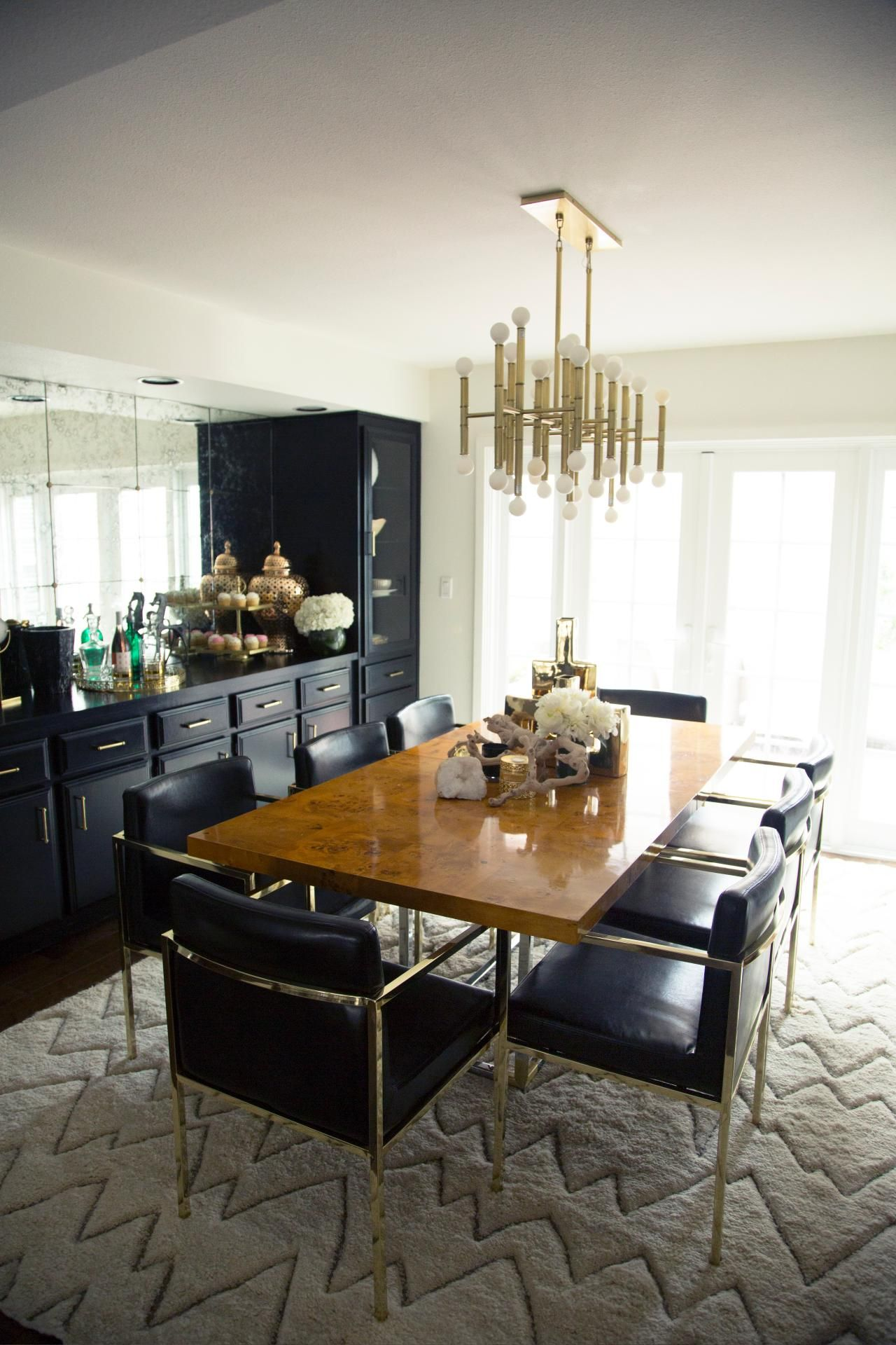 Black Leather Chairs With Polished Brass Frames Surround A Sleek Delectable Picture Frames For Dining Room Review
