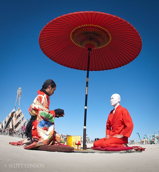 Funny Burning Man Memes Of 2017 On Sizzle: A Red Umbrella Under A Really Blue Sky.