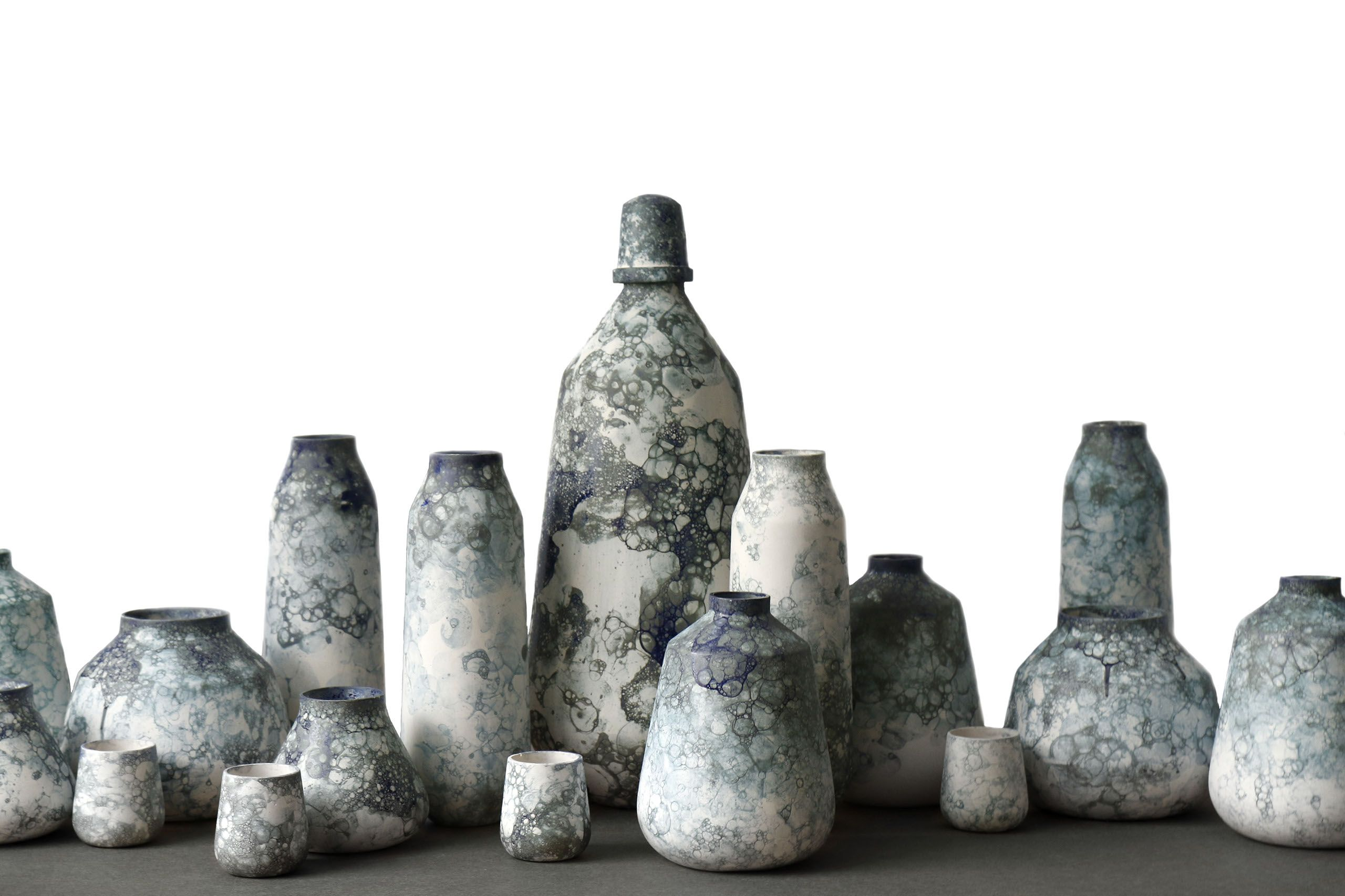STUDIO ODDNESS BUBBLEGRAPHY is a series of ceramic vases finished with a soap glaze. By blowing air into the glaze, and in doing so creating bubbles in which the vases are dipped, a mesmerizing play on the exterior of the vase is created.