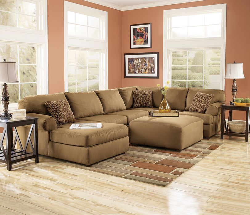 Kimbrell S Living Room Sets: Large Brown Sectional Sofa Against Soft, Mauve-colored