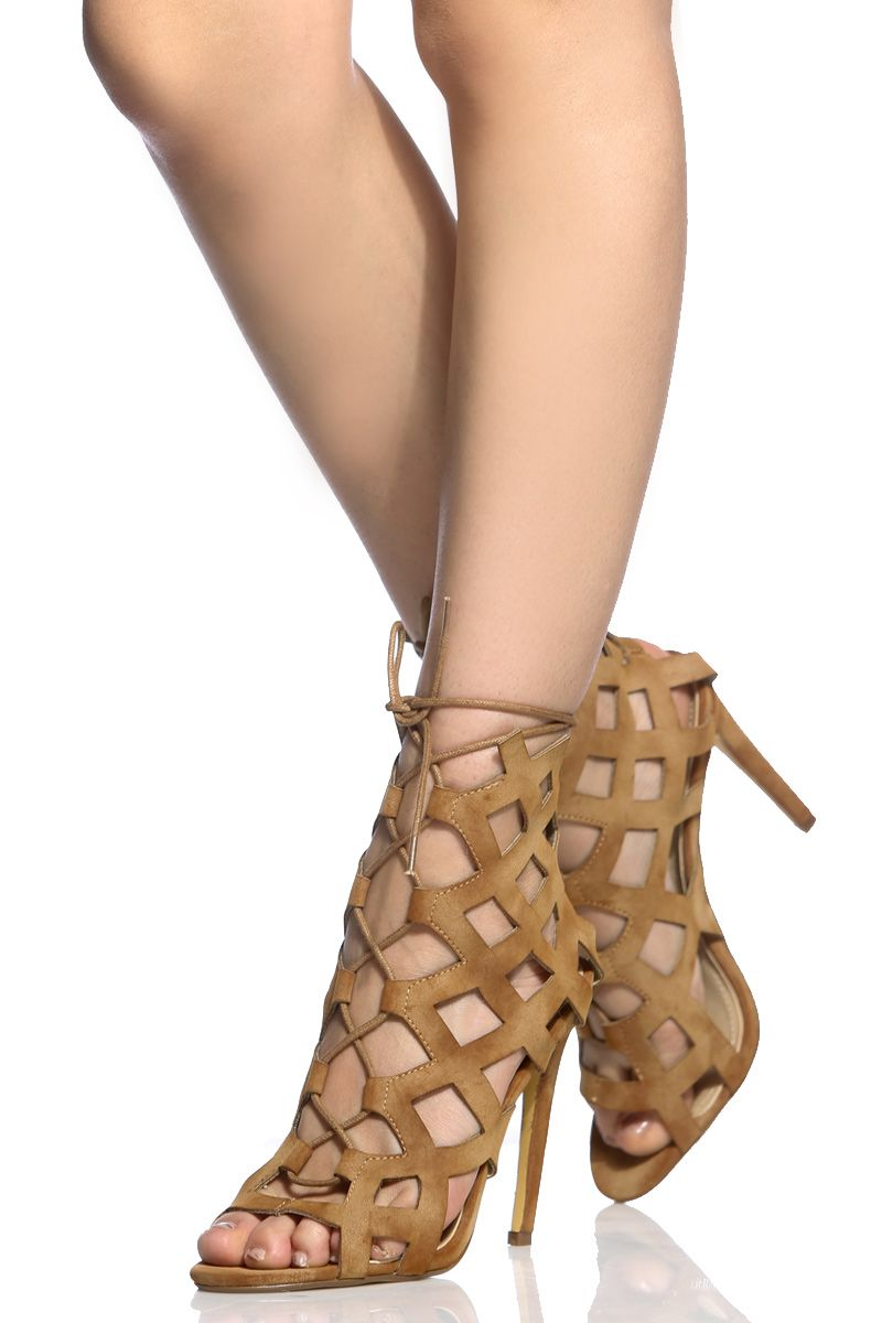 Make a statement where ever you go in this wardrobe essential! This pair features a faux suede material, laser cut detailing, lace up construction, single soles, peep toe cut and cushioned insoles. Wear this pair with your favorite midi and take on the night in major style!-True to size(Sizing may vary based on foot width)