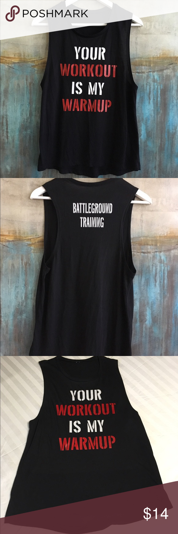 """Graphic Muscle Tee Size Small Graphic muscle tee with cut out sleeveless design and graphic on chest """"Your workout is my warm up"""" Size Small Color Black. Material 60/40 Cotton/Poly. Measurements: shoulders: 12, pits: 16, top to bottom: 25 Tops Muscle Tees"""