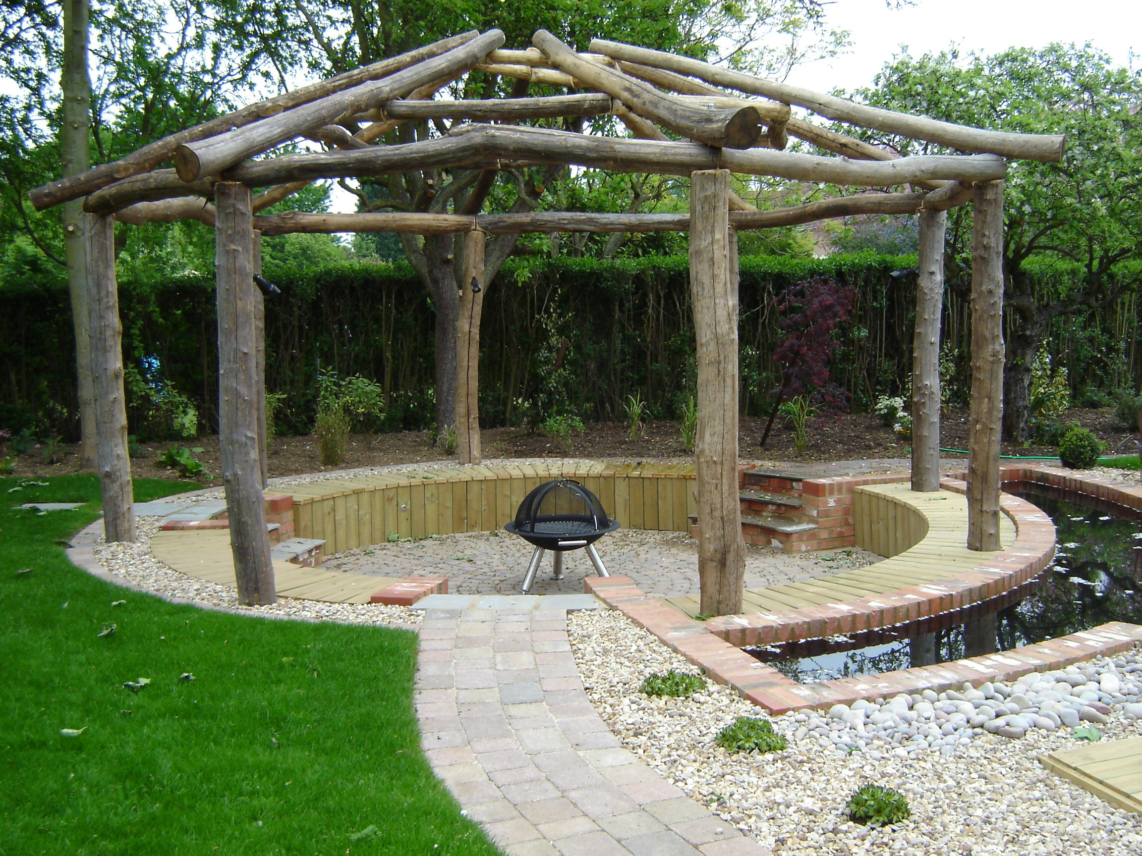 A sunken seating area with firepit and water channel