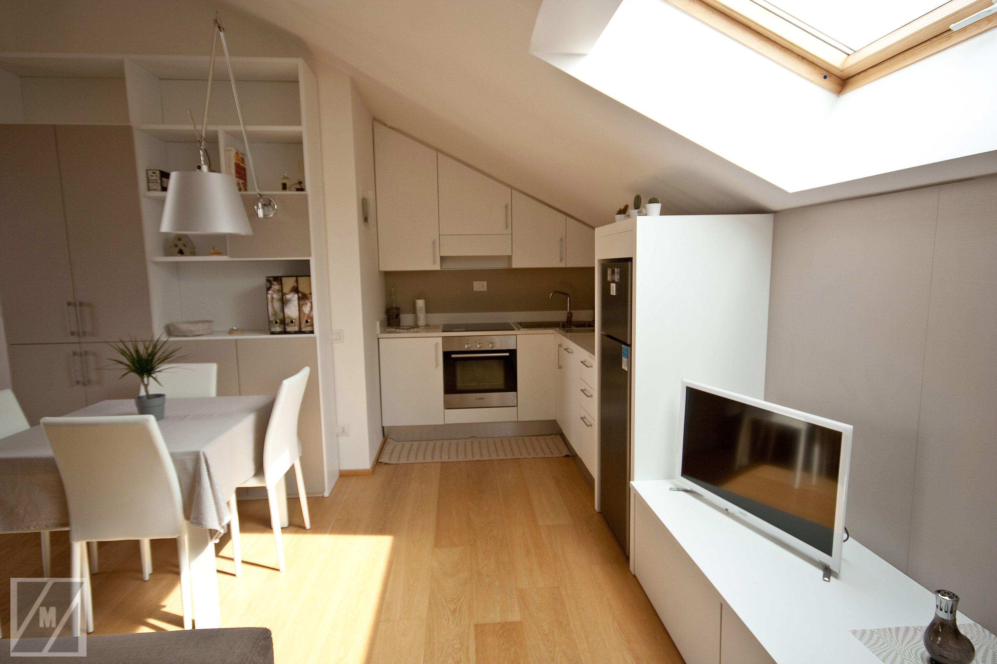 Cucina e living in mansarda arredamento mansarde nel for Rollandi arredamenti