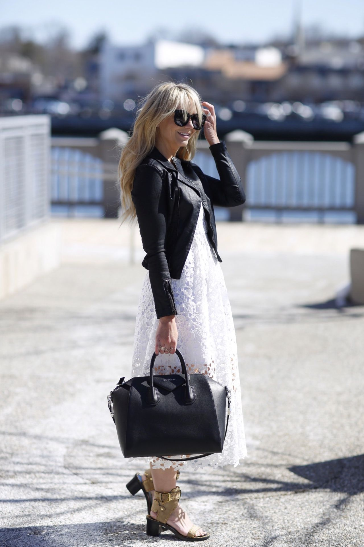 Every girl needs this white lace dress in her closet. Looks more casual paired with this edgy black jacket.
