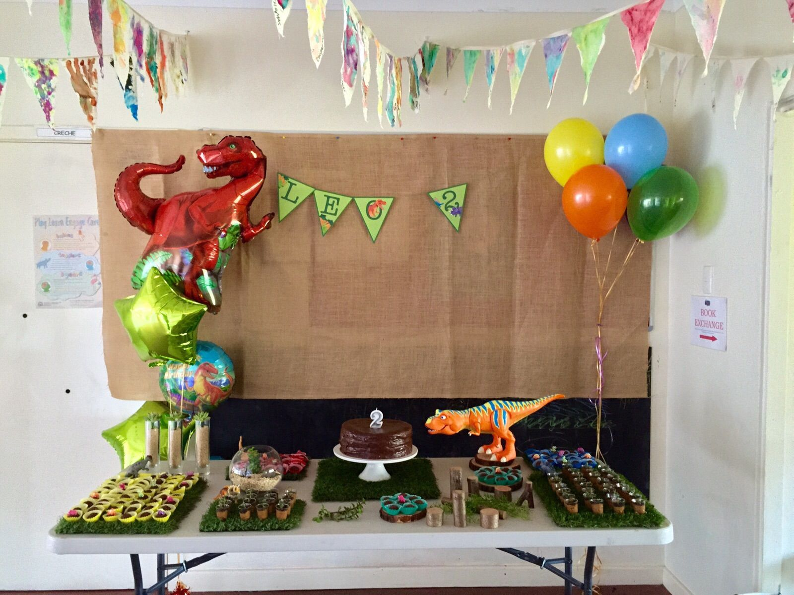 Leo's dinosaur bday party. Cake table. Lots of artificial lawn brought a special touch.