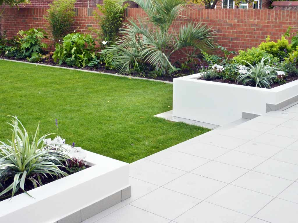 Contemporary style rendered walls and raised beds Garden