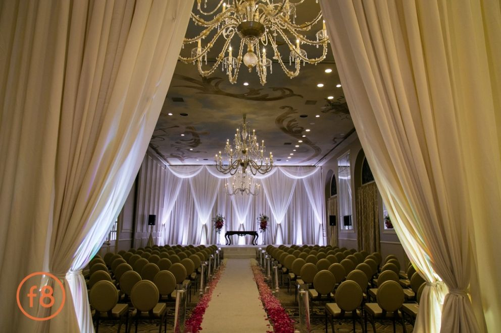 dramatic ceremony decor in the large ballroom at the adolphus hotel white carpet runner