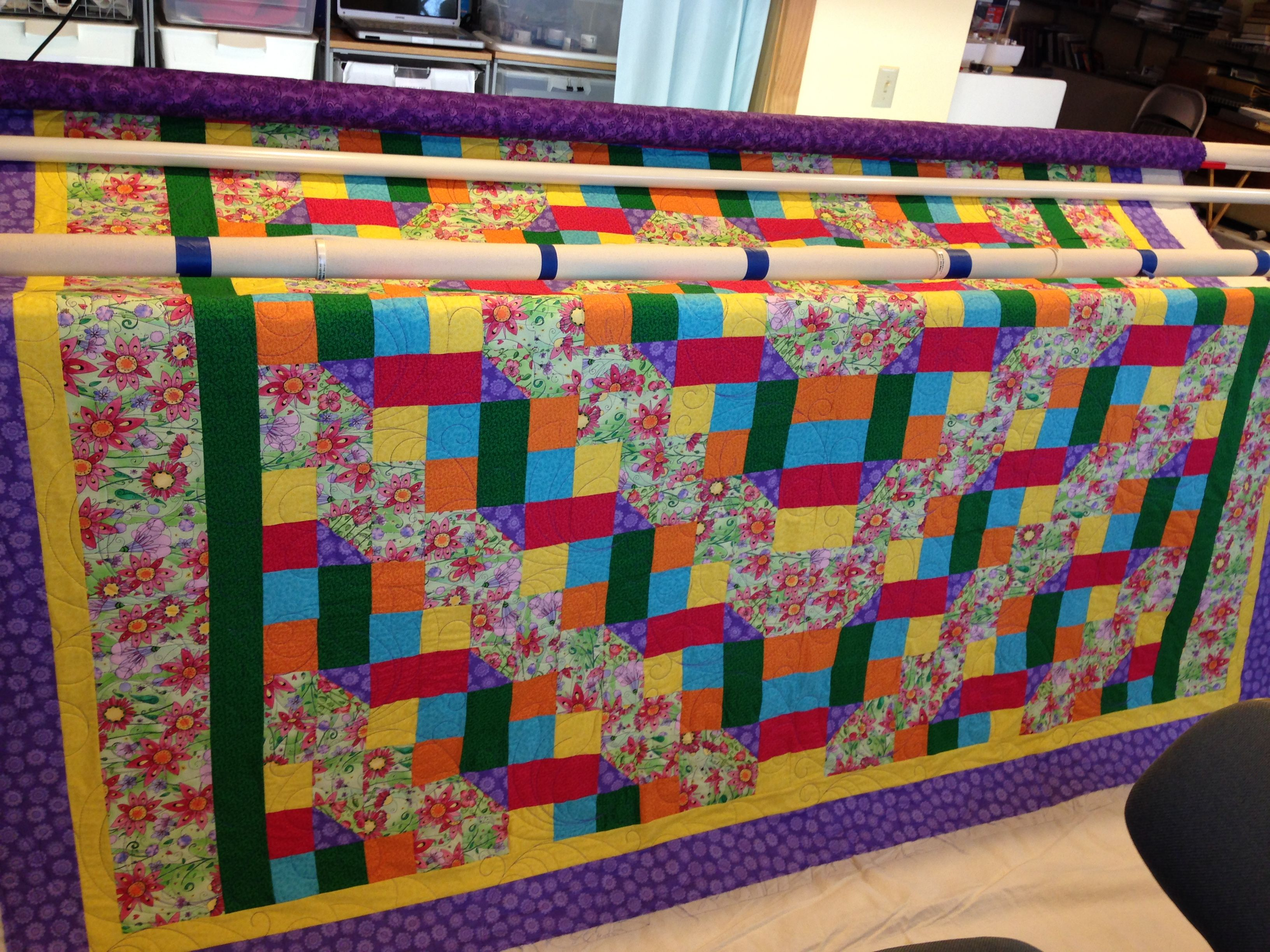 Garden Path design by Anita Hollock made with a limited number of colors which changes the look of the whole quilt.  Made and quilted by Mrs. B and Institches2014!