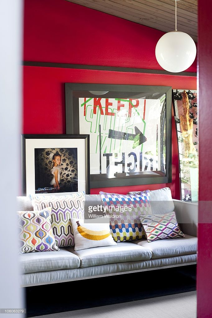 Actress <a gi-track='captionPersonalityLinkClicked' href=/galleries/search?phrase=Robin+Tunney&family=editorial&specificpeople=217771 ng-click='$event.stopPropagation()'>Robin Tunney</a>'s house in Los Angeles, CA. Sofa with colorful pillows.
