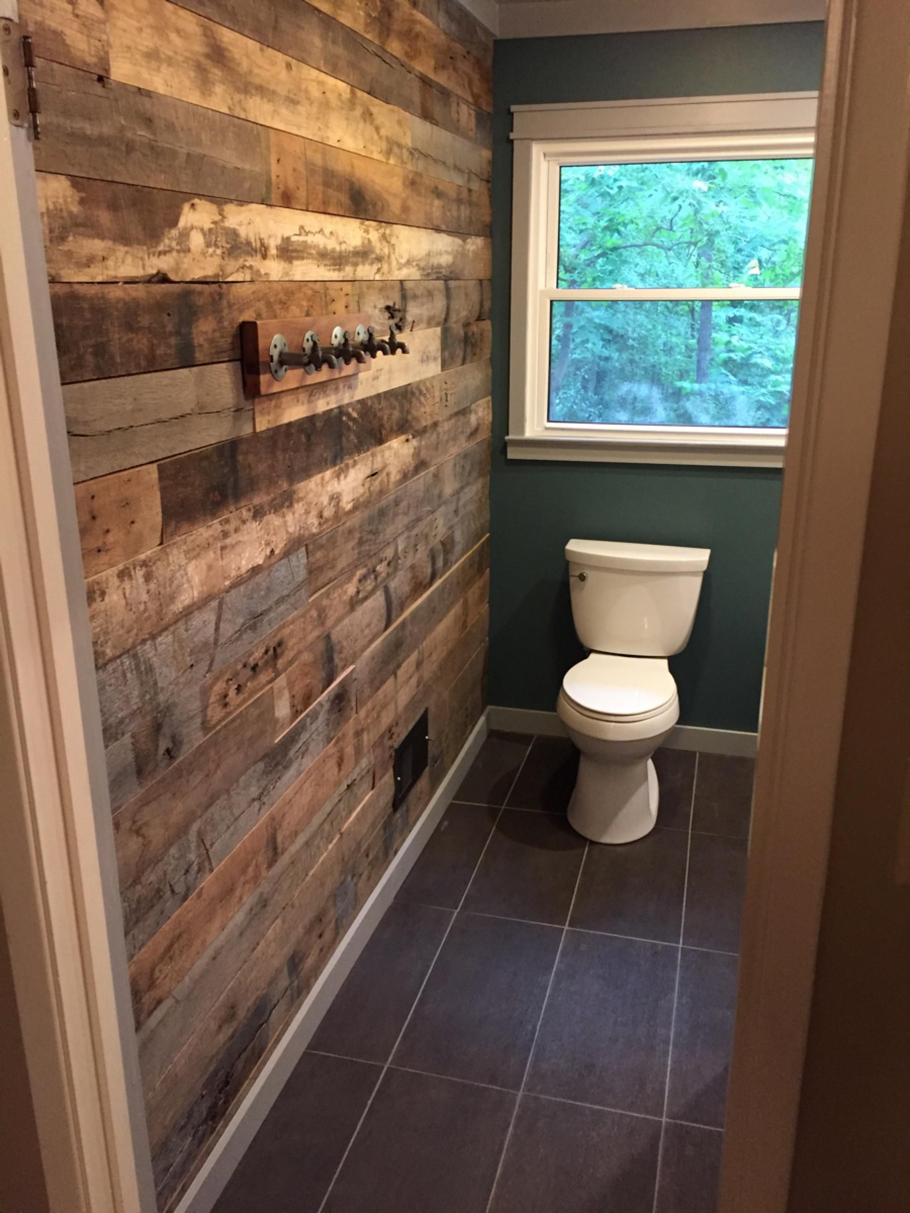 Bathroom accent wall from reclaimed barn wood