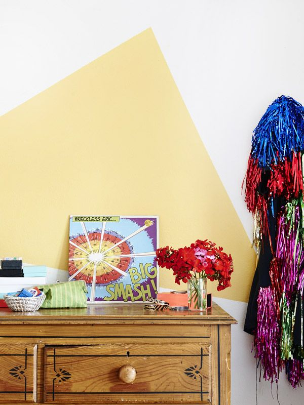 Yellow Geometric Shape Painted Onto Wall By Graphic Designer Adelaide Daniell In Her Parkville Home
