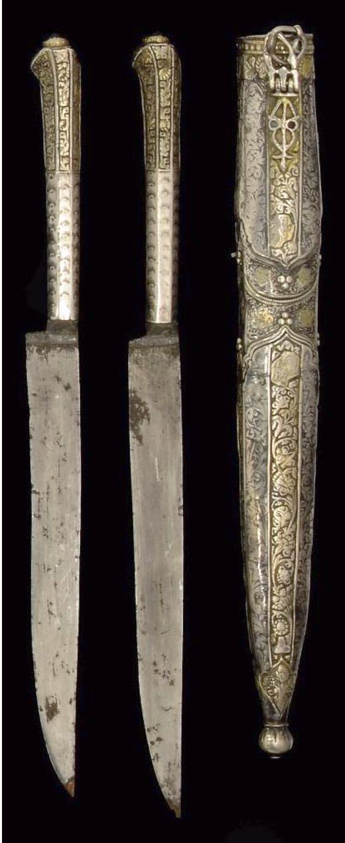 Ottoman traveling knives (trousse), 1703 to 1730, each with straight blade, the faceted handle with gilt floral decoration to upper section, capped at end with garnet, sheath of silver with niello and silver gilt panels engraved with floral decoration and stamped with the tugra of Ahmed III . knife 7 1/2in (19cm) long; whole 8 1/2in (21.5cm) long.