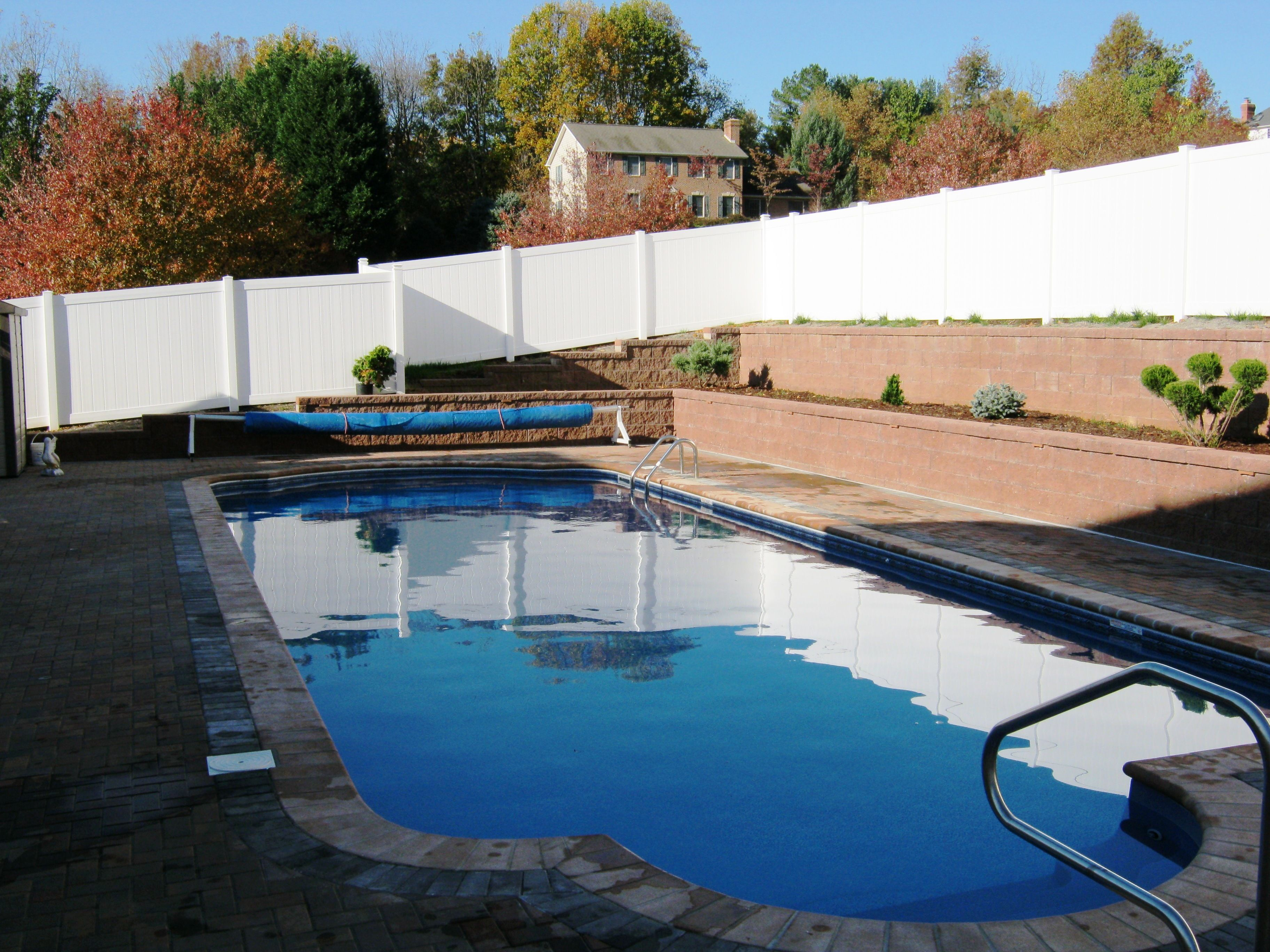 Roman With Double Retaining Walls Brick Coping Paver Deck And Vinyl Fence Our Beautiful