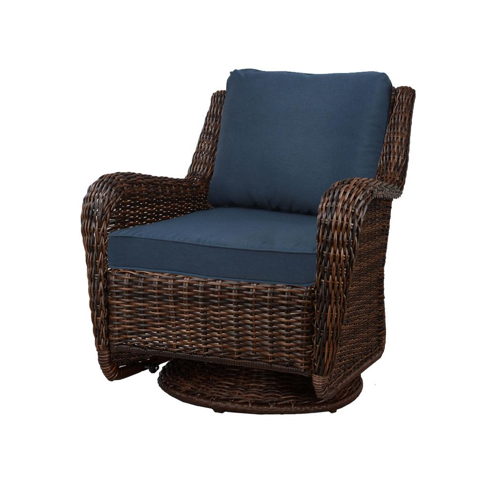 Hampton Bay Cambridge Brown Wicker Swivel Outdoor Rocking Chair With Blue Cushions Swivel Rocking Chair Blue Cushions Outdoor Wicker Rocking Chairs