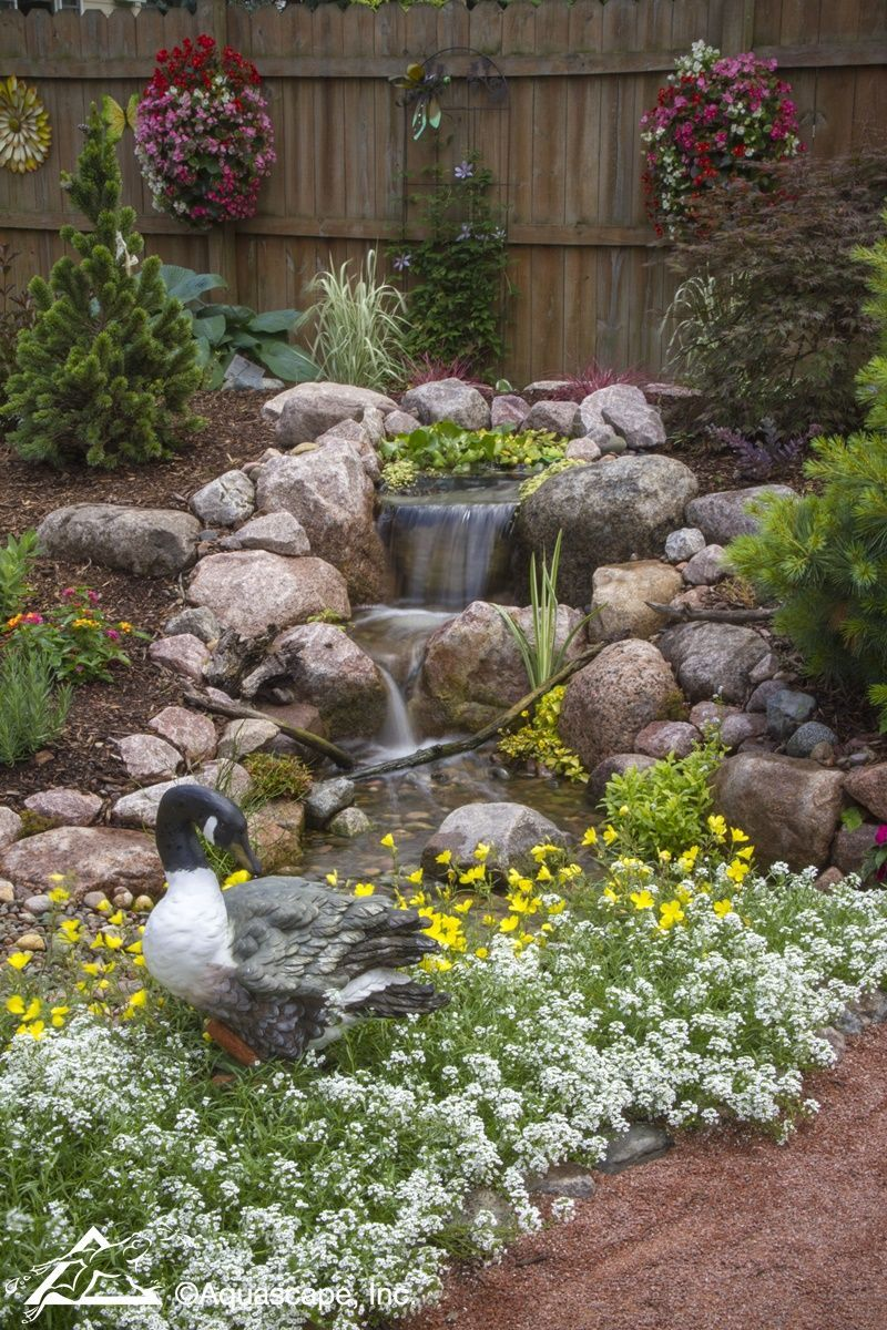 A Berm Lends Itself Perfectly to This Stunning Pondless ... on Front Yard Waterfall Ideas id=19244